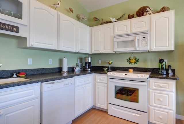 Kitchen with Range and Microwave Hood